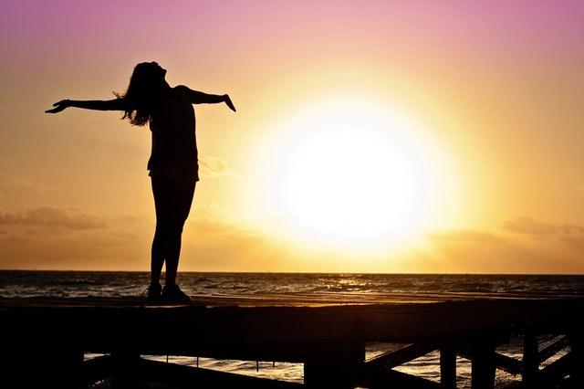 silhouette of a girl in sunshade near beach