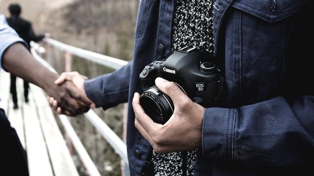 hand shaking photographer